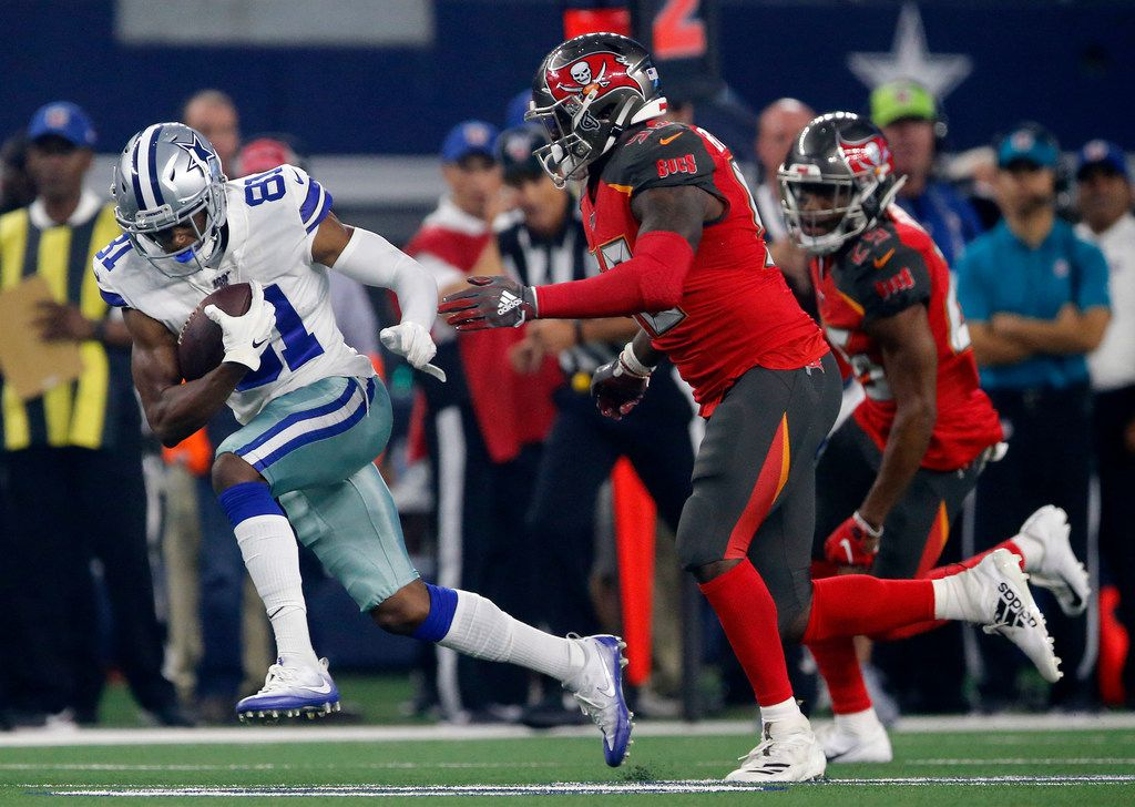 Dallas Cowboys wide receiver Jon'Vea Johnson (81) breaks away after making a first quarter reception against Tampa Bay Buccaneers linebacker Shaquil Barrett (58) in their preseason game at AT&T Stadium in Arlington, Texas, Thursday, August 29, 2019.