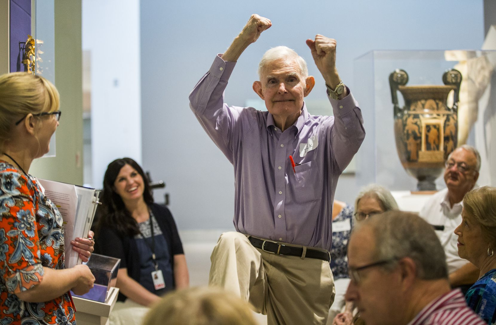 Dick Bernet makes a pole vaulting motion during a presentation on the Olympics and ancient Greece as part of the Meaningful Moments Program for individuals with early stages of dementia on Tuesday, August 16, 2016 at the DMA.