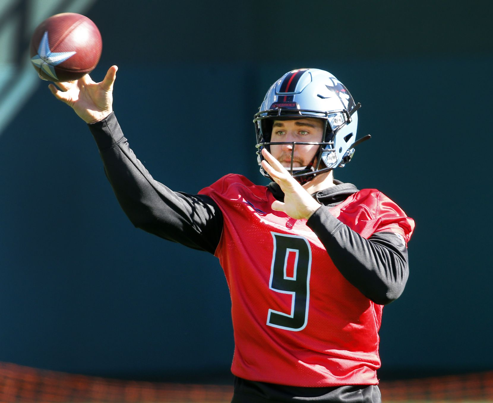 Dallas Renegades quarterback Philip Nelson (9) throws a pass during practice on the newly constructed football field at Globe Life Park in Arlington, Texas, Saturday, February 1, 2020. Nelson may start if Landry Jones hasn't fully recovered from an injury. Their season starts February 9.