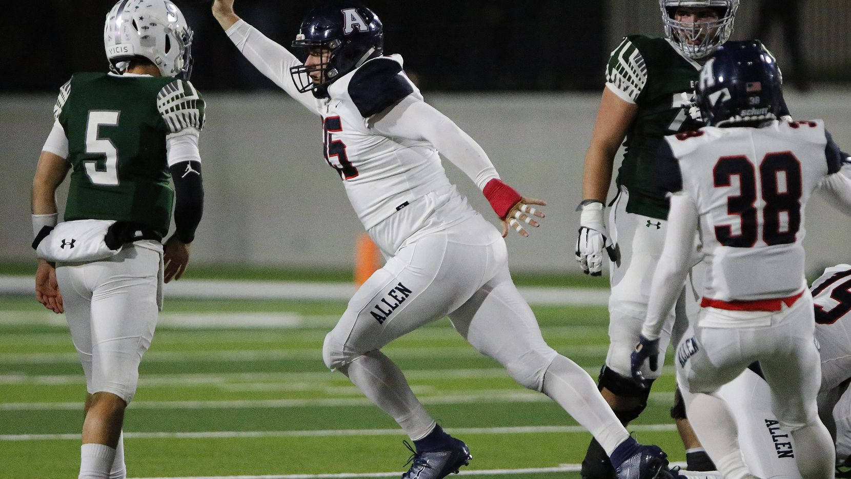 Allen High School defensive lineman Elijah Fisher (95) emerges with a fumble recovery during the first half as Prosper High School hosted Allen High School in a District 9-6A football game at Children's Health Stadium in Prosper on Friday night, Novembrer 1, 2019. (Stewart F. House/Special Contributor)