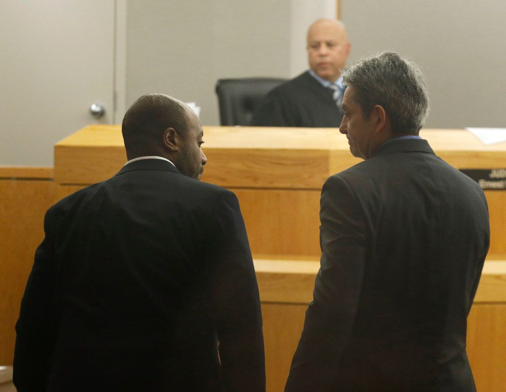 Former Farmers Branch police Officer Ken Johnson (left) talked with his attorney, Tim Menchu, during jury deliberations in his sentencing trial Tuesday.