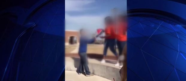 Students tussled over a Confederate flag at Eaton High School on Tuesday. Their faces have been intentionally blurred.