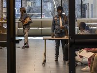 People wait at the DeSoto Public Library for a COVID-19 vaccination registration drive held by the Dallas County Health and Human Services Community Outreach Team on Tuesday, Feb. 23, 2021, in DeSoto, Texas. (Lynda M. González/The Dallas Morning News)