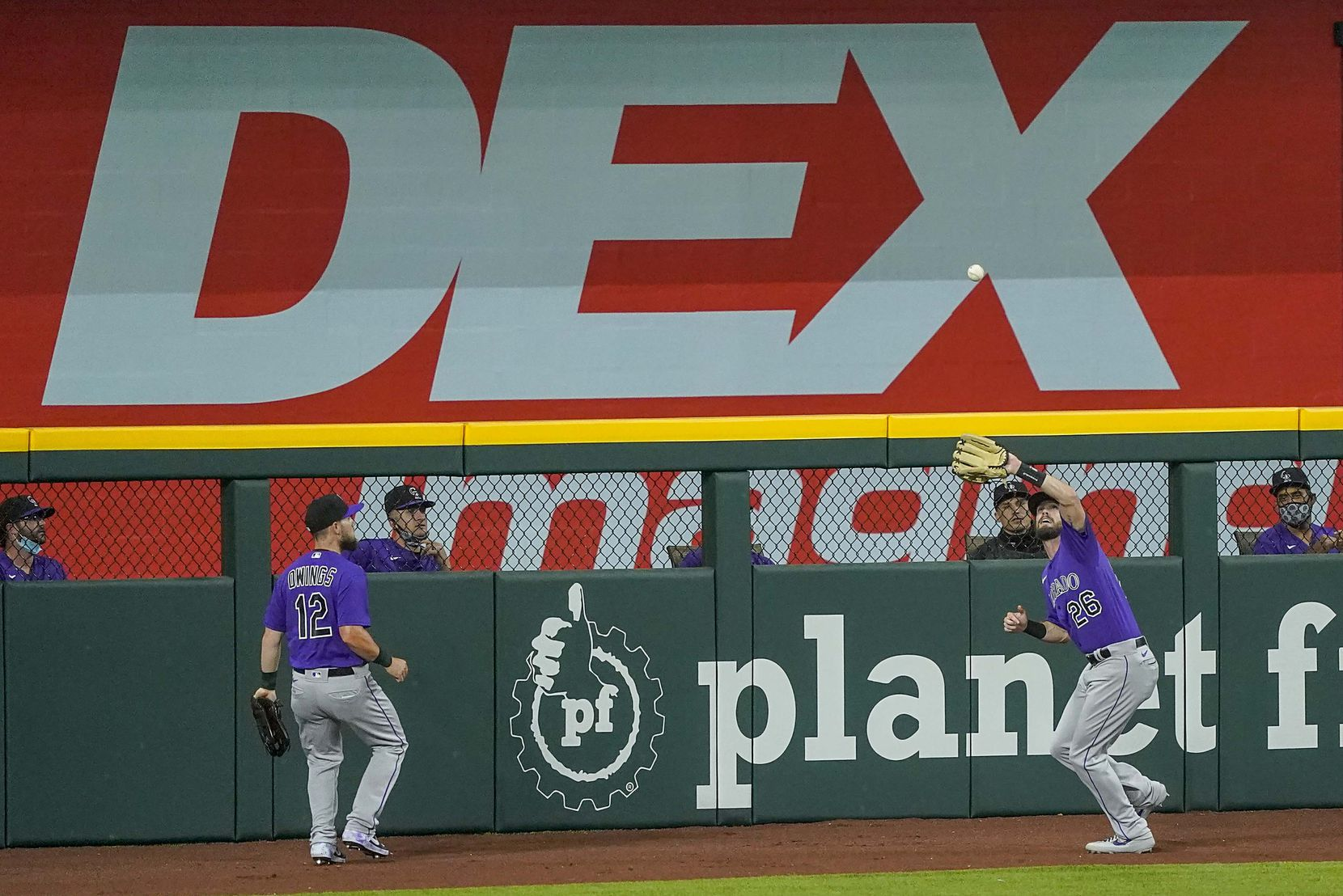 Colorado Rockies left fielder David Dahl makes a catch at the wall on a line drive off the bat of Texas Rangers outfielder Danny Santana during the second inning of an exhibition game at Globe Life Field on Wednesday, July 22, 2020. (Smiley N. Pool/The Dallas Morning News)