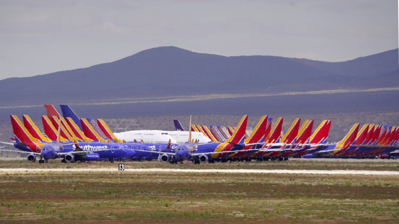 Southwest Airlines aircraft are seen stored at Southern California Logistics Airport, Wednesday, March 25, 2020, in Victorville, Calif.
