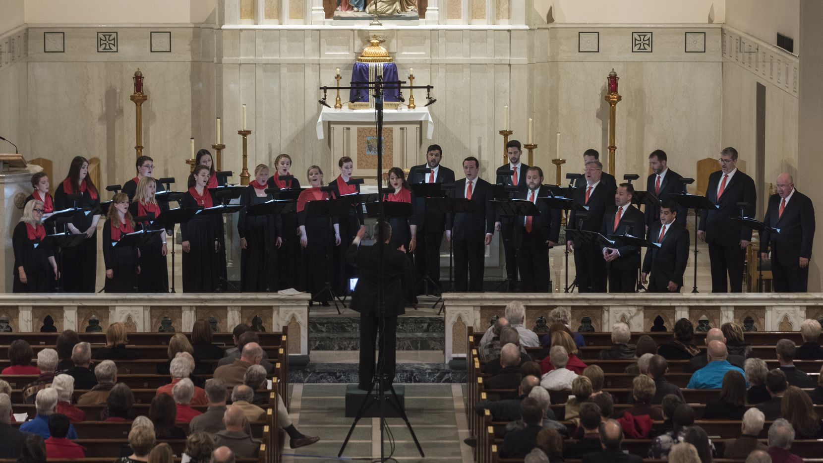 The Orpheus Chamber Singers perform their Christmas concert at St. Thomas Aquinas Catholic Church on Saturday, Dec. 17, 2016.