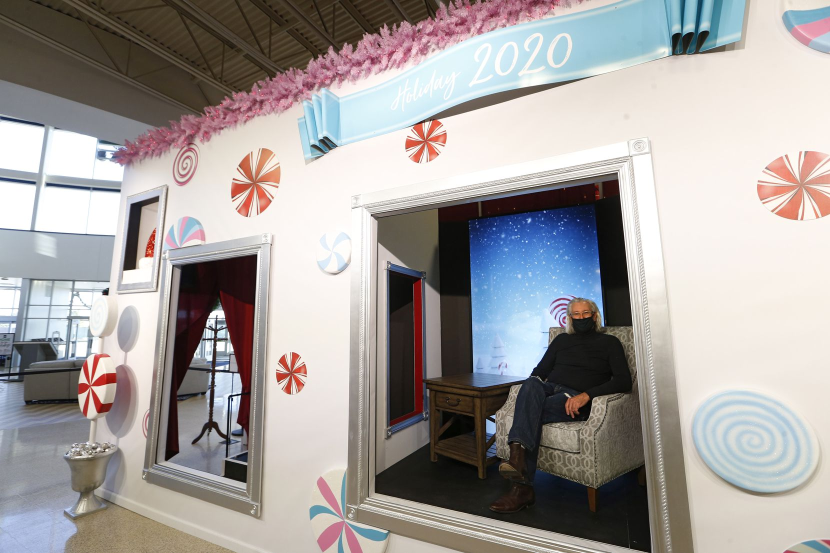 Ignaz Gorischek posed for a portrait in the Santa seat at Nebraska Furniture Mart in The Colony. Santa can sit in the center booth and visit with children in the side rooms next to him. Gorischek created the socially distanced exhibit.