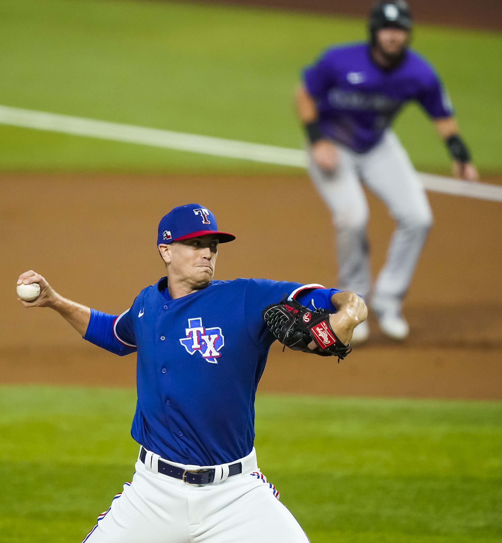Texas Rangers pitcher Kyle Gibson pitches as Colorado Rockies outfielder David Dahl takes a lead off of first base during the first inning of at Globe Life Field on Tuesday, July 21, 2020.