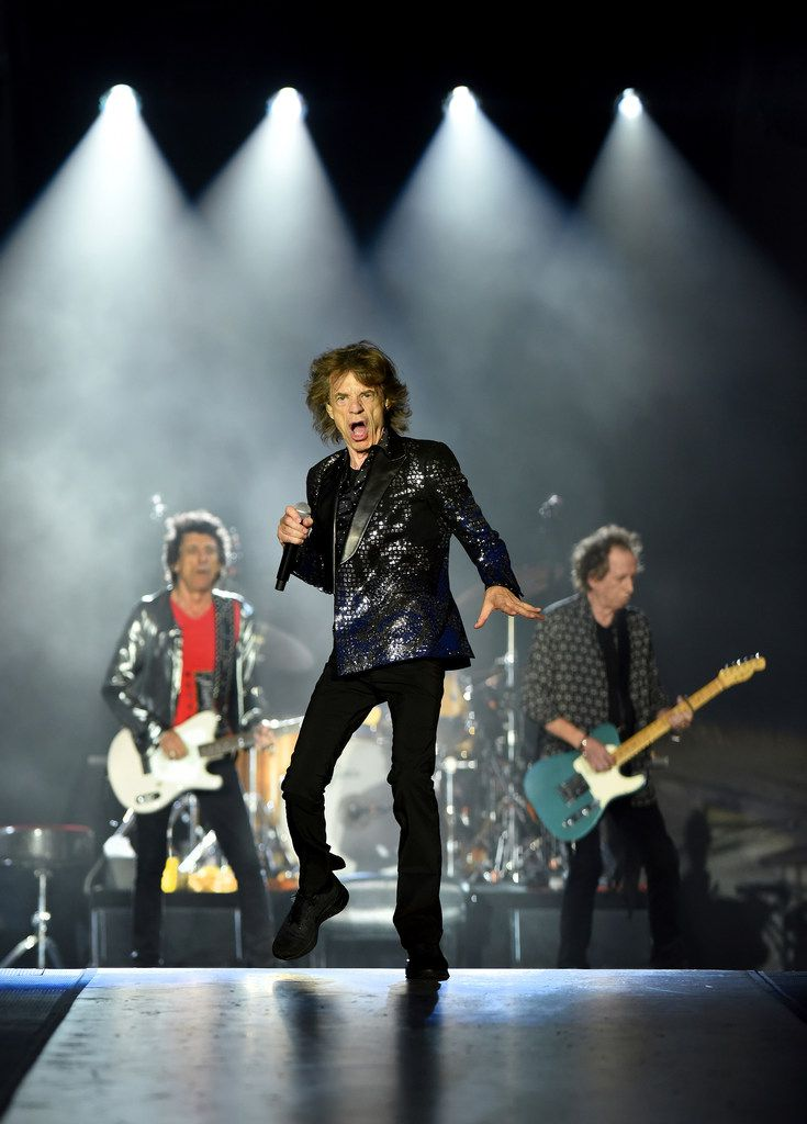 The Rolling Stones' lead vocalist Mick Jagger performs flanked by bandmates Ronnie Wood, left, and Keith Richards in Jacksonville, Fla. on Friday, July 19, 2019.