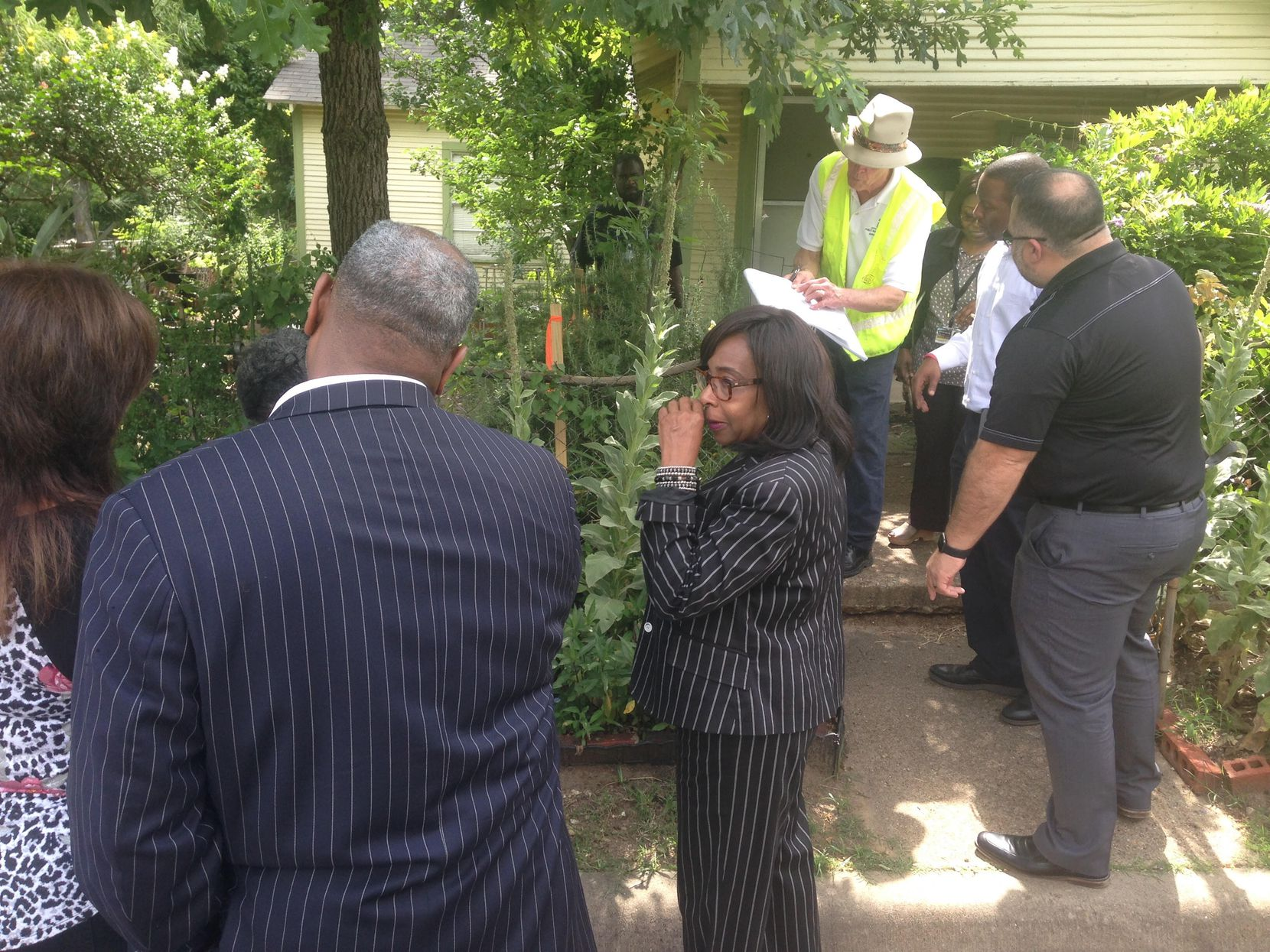 Council member Carolyn King Arnold (center) and some 20 city staffers met at Diane Wynn's house Thursday morning to discuss how much of her land the city needs for the improvements coming to The Bottom.