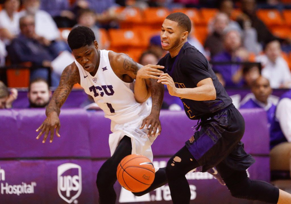 Dec 11, 2015; Fort Worth, TX, USA; TCU Horned Frogs guard Chauncey Collins (1) and Prairie View A&M Panthers guard Jordan Giddings (3) battle for a loose ball during the first half at Wilkerson-Greines Athletic Center. Mandatory Credit: Kevin Jairaj-USA TODAY Sports