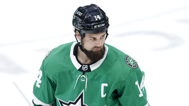Dallas Stars left wing Jamie Benn (14) eyes the Carolina Hurricanes bench as he skates to the bench in the first period at the American Airlines Center in Dallas, Tuesday, April 27, 2021.