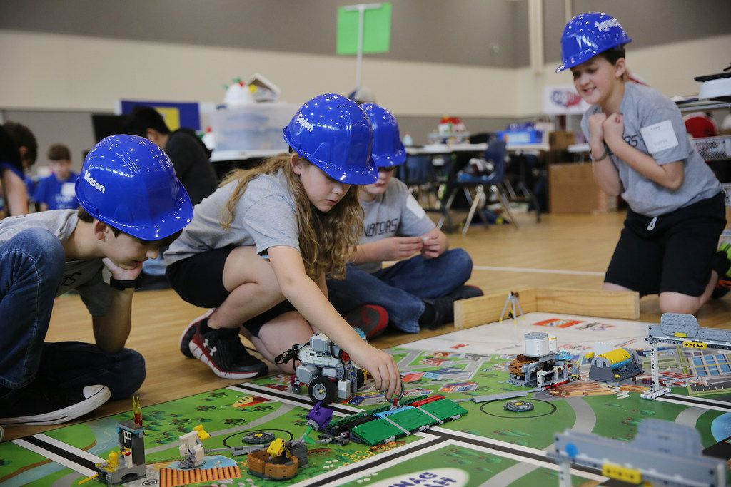 From left: Mason Cashion, 10; Caden Jones, 11; Josh Andrews, 10, and Ryan Chappotin, 11, all from Hajek Elementary in Burleson, compete in the 10th annual North Texas First LEGO League Championship Robotics Tournament at Parish Episcopal School in Farmers Branch. Extracurricular programs that encourage inventiveness, especially with regard to technology, are one way to prepare kids for a rapidly changing future.
