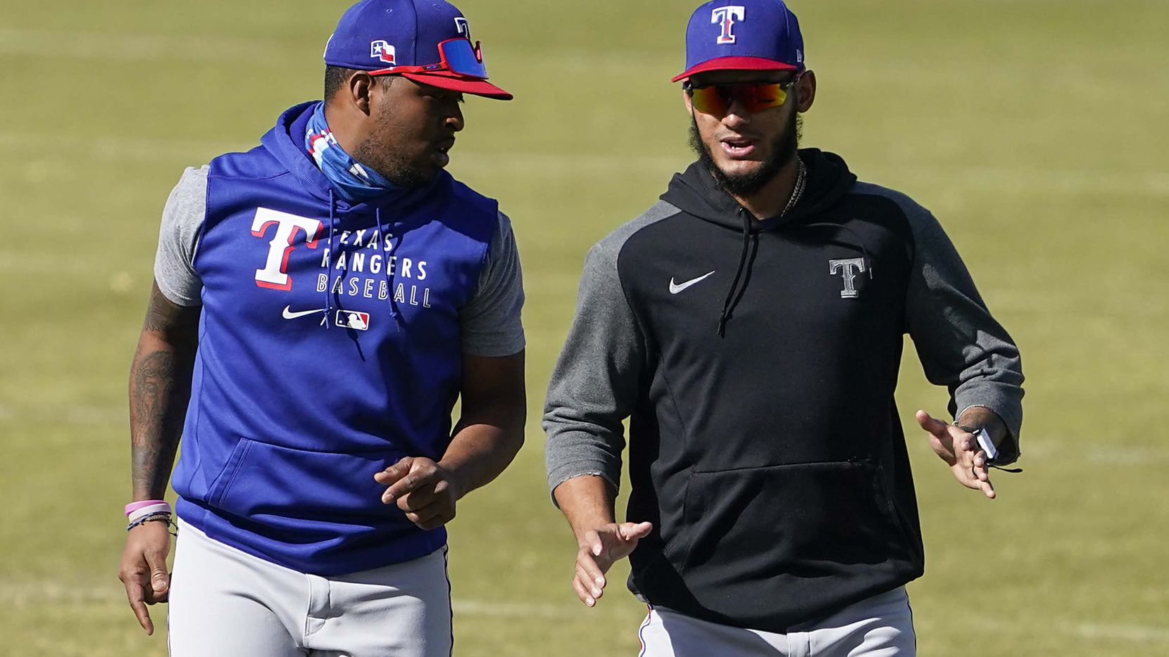 Rangers pitchers Jonathan Hernández (right) and Alex Speas are pictured during a workout at the team's spring training facility on Saturday, March 6, 2021, in Surprise, Ariz.