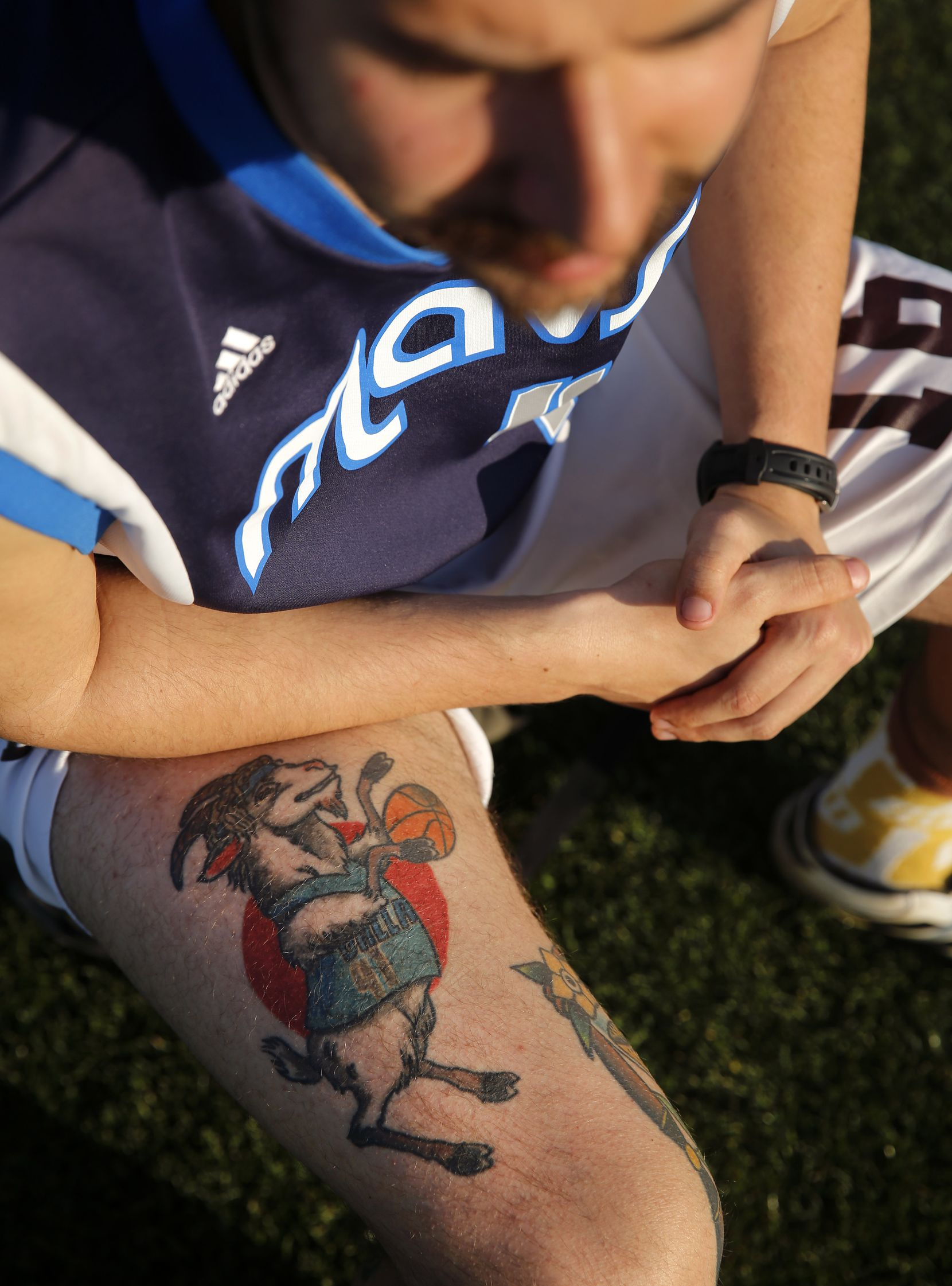 Mark Campbell displays his tattoo of the GOAT (Greatest of All Time) and Dallas Mavericks All-Star forward Dirk Nowitzki.