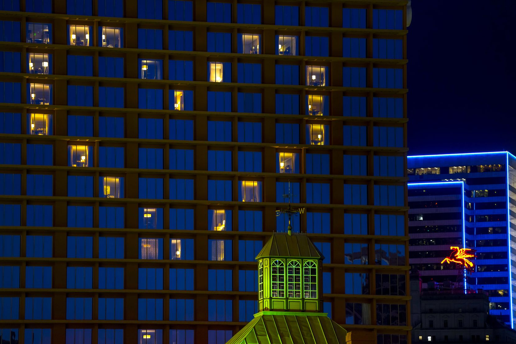 The lights from empty rooms at the Fairmont Dallas hotel formed the shape of a heart on March 28, 2020. Most of the people living in Dallas-Fort Worth were under strict rules to stay home except to buy groceries or pick up medicine in response to the  COVID-19 pandemic.