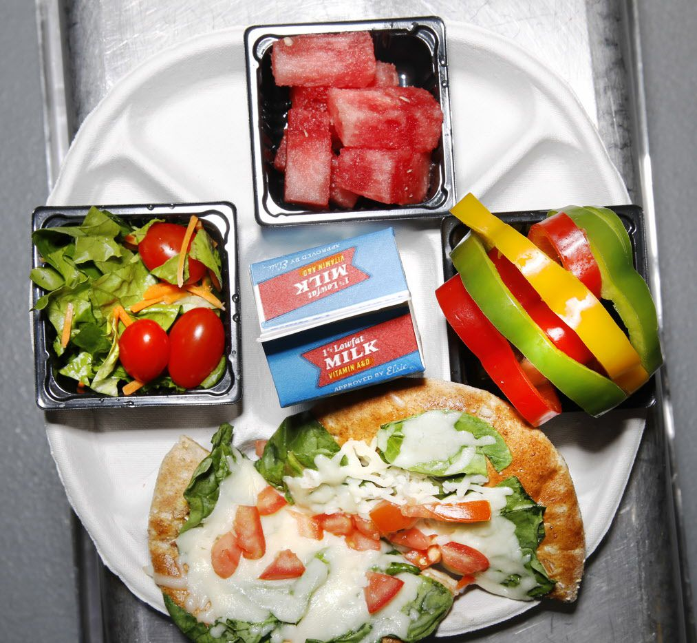 DISD school lunches reviewed: Restaurant critic Leslie Brenner went to Dallas Independent School District's production facility to taste-test the district's new healthy 'Smart Box' lunches.  One was this Mediterranean Combo Meal with spinach-cheese flatbread and Texas watermelon.