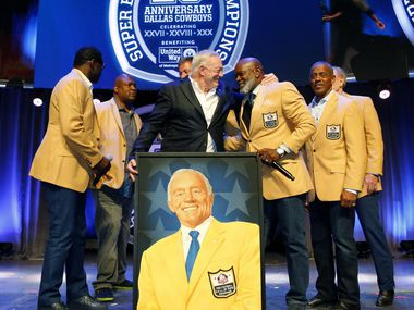 Dallas Cowboys owner Jerry Jones (center) gives a big hug to Emmitt Smith after a painted portrait of the newest Cowboy NFL Hall of Famer was given him during the 25th Anniversary of the Dallas Cowboys Super Bowl XXVII at Gilley's in Dallas, Saturday, February 25, 2017. The event was hosted by Troy Aikman and United Way of Metropolitan of Dallas in which he is the new fundraiser. The evening featured appearances by Cowboys legends, a conversation with head coach Jimmy Johnson and other members of the 1992 coaching staff, and a special celebration honoring Jerry Jones for his election to the Pro Football Hall of Fame.