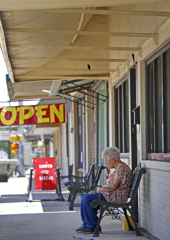 Resident Mary Beyer takes a smoke break in downtown Rockdale, Texas, Thursday, June 14, 2018.