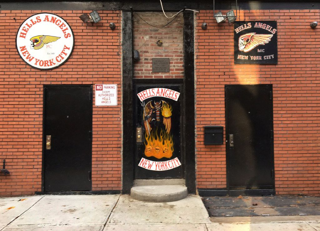 """A sign near the front door of the Hells Angels motorcycle club headquarters in New York reads """"No Parking Except Authorized Hells Angels,"""" Friday, Dec. 16, 2016. (AP Photo/Tom Hays)"""
