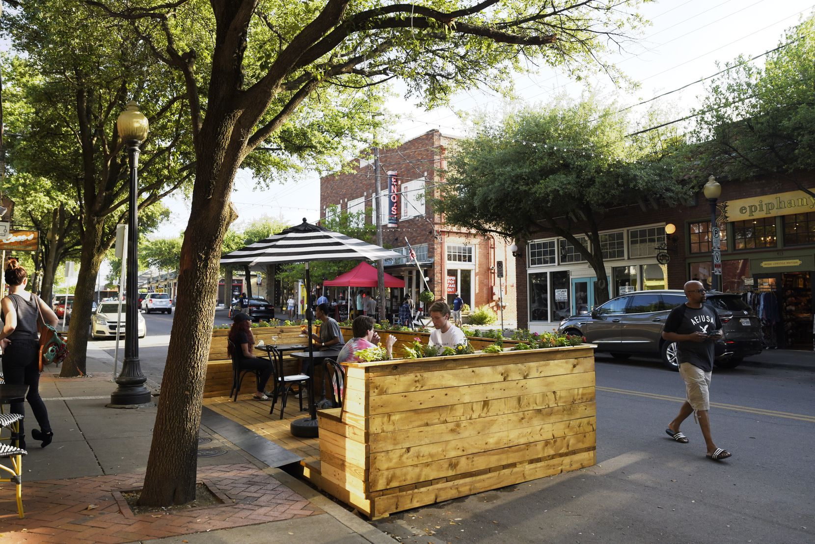 A temporary seating area outside of Revelers Hall on Bishop Avenue in Dallas, Friday, May 15, 2020. Co-owner Jason Roberts said the built structure is an example of a more semi-permanent parklet, or outdoor seating area that spills out onto a street.