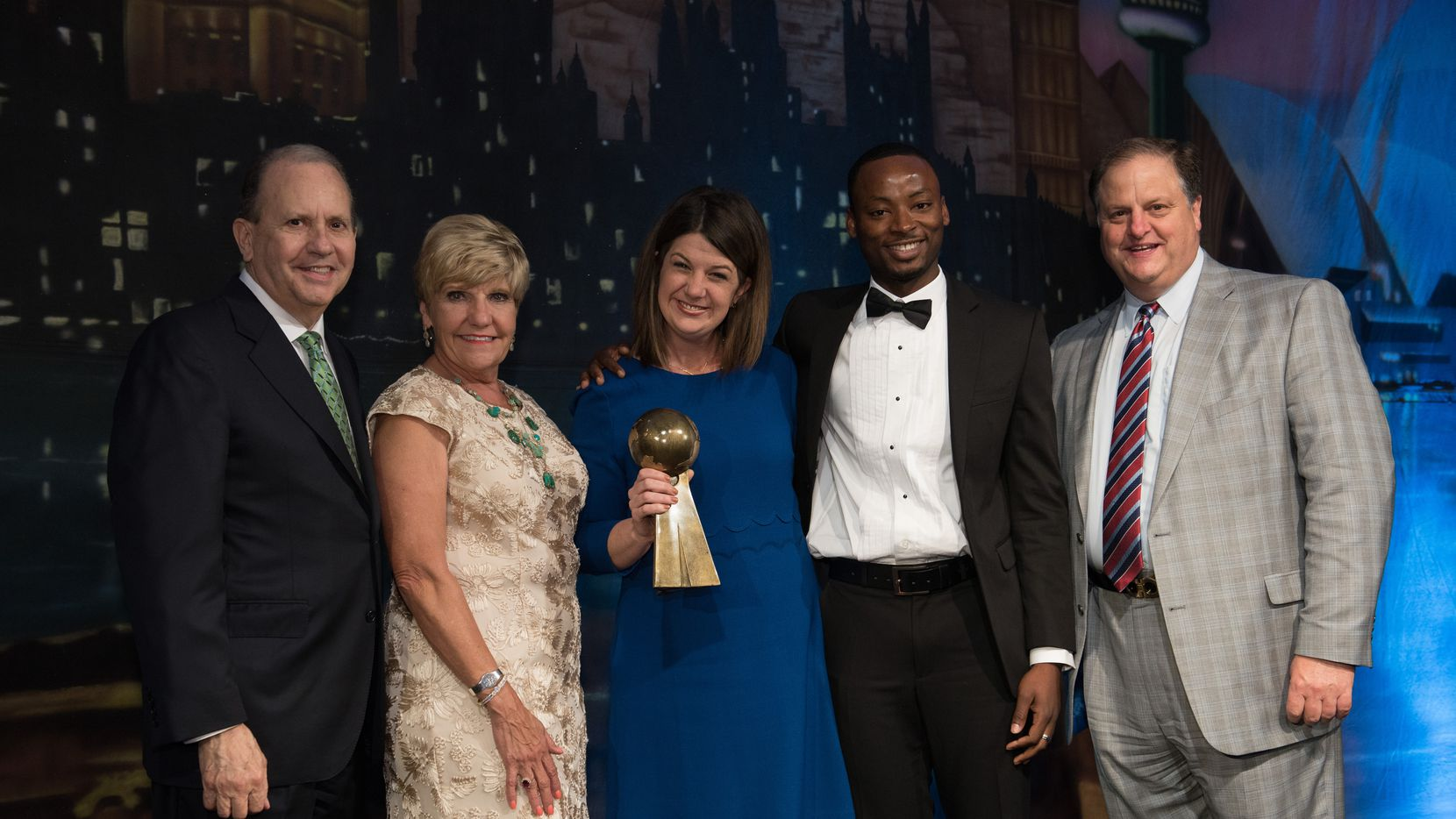 From left, Kenneth Barr, Mayor Betsy Price, Heather Reynolds, Jimmy Alphonce and Johnny Campbell at Fort Worth Sister Cities Mayor's International Dinner at the Omni Hotel in Fort Worth.