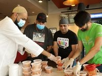 Azhar Subedar (from left), Ram Mehta, Ali Siraj and Ali Samana organize freshly prepared meals for delivery at In-Fretta in Plano on April 2, 2020.