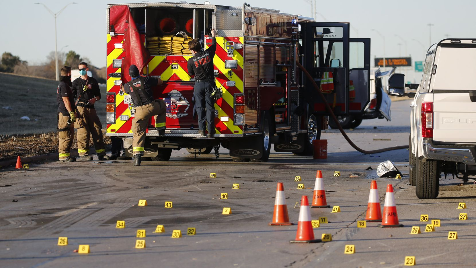 Grand Prairie firefighters at the scene of a fatal plane crash near the intersection of Mayfield Road and Highway 360 on Monday, December 21, 2020 in Grand Prairie, Texas.