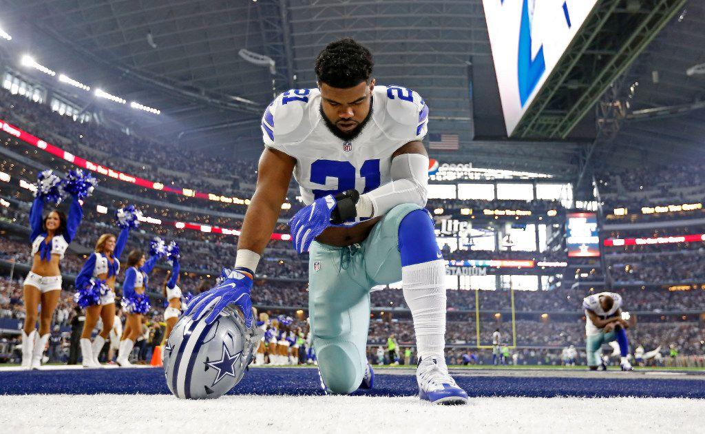 Dallas Cowboys running back Ezekiel Elliott (21) prays on the field prior to the kick off between Dallas Cowboys and Green Bay Packers at AT&T Stadium in Arlington, Texas, Sunday, Jan. 15, 2017. (Jae S. Lee/The Dallas Morning News)