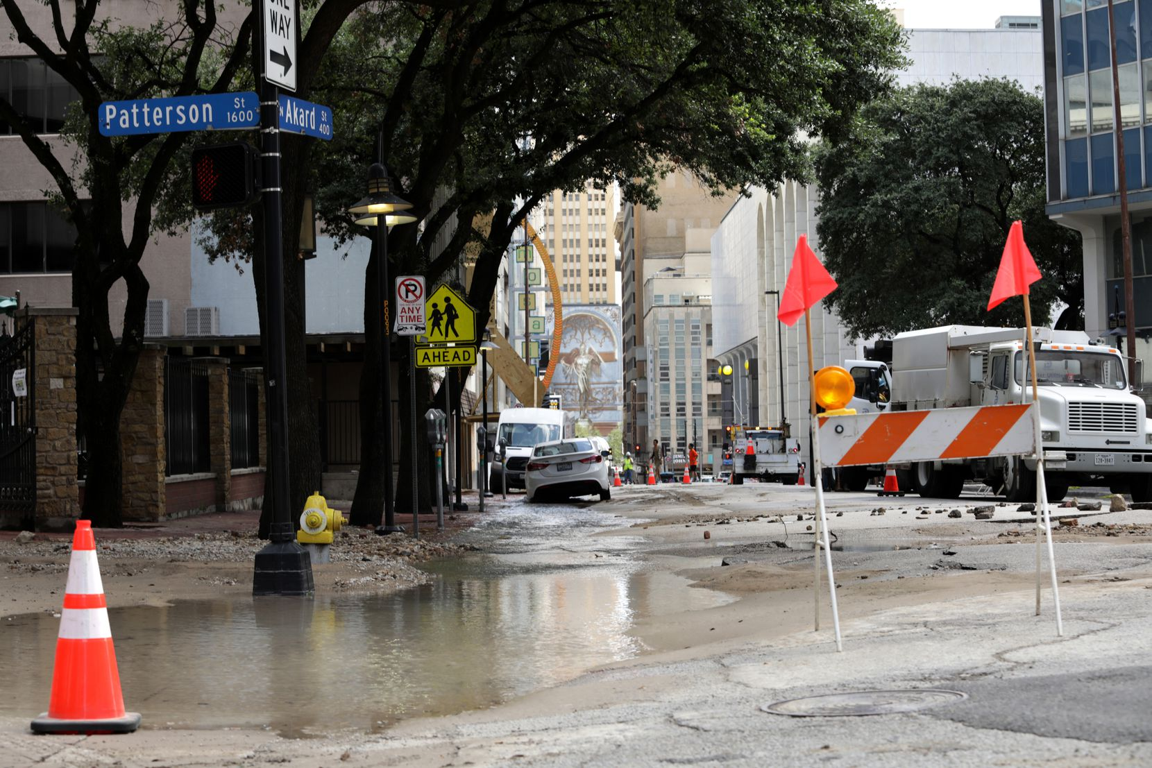 Water was still seeping from the ground hours after the initial break around 1 p.m.