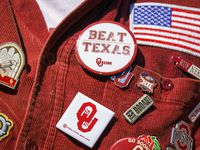 """A Oklahoma Ruf Nek wears a weathered """"Beat Texas"""" button during the second half of an NCAA football game at the Cotton Bowl on Saturday, Oct. 12, 2019, in Dallas."""