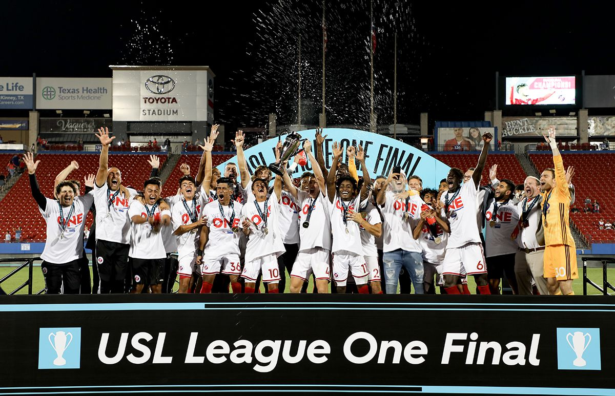 North Texas SC hoists the 1st ever USL League One Final trophy at Toyota Stadium, October 19, 2019.