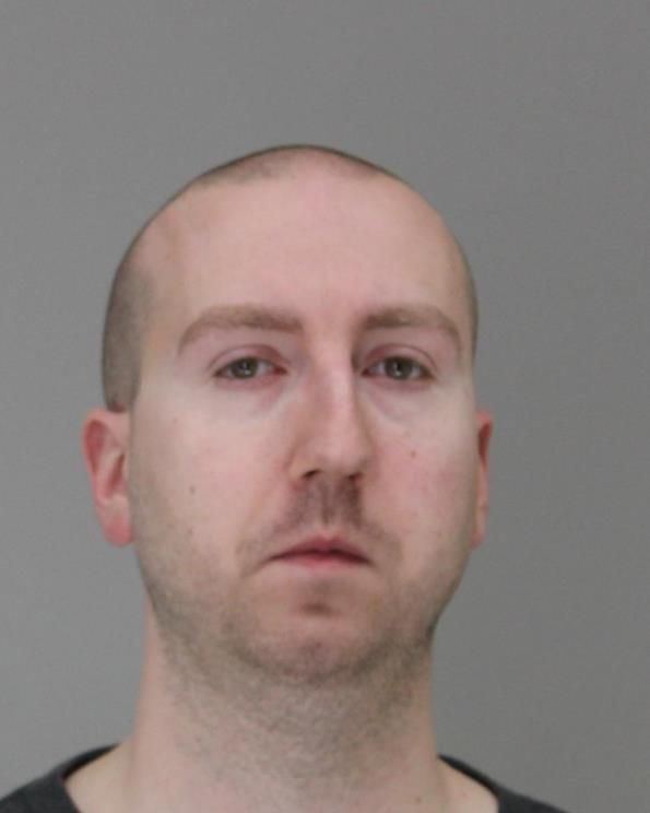 Dallas County Sheriff's Deputy Austin Palmer, 33, was arrested Jan. 16, 2020, on charges of official oppression and assault, according to the sheriff's office.
