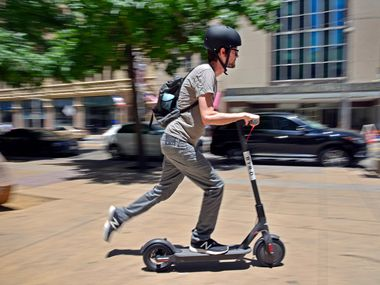 Justin Pierce, 31, tries out a Bird electric scooter in this file photo.