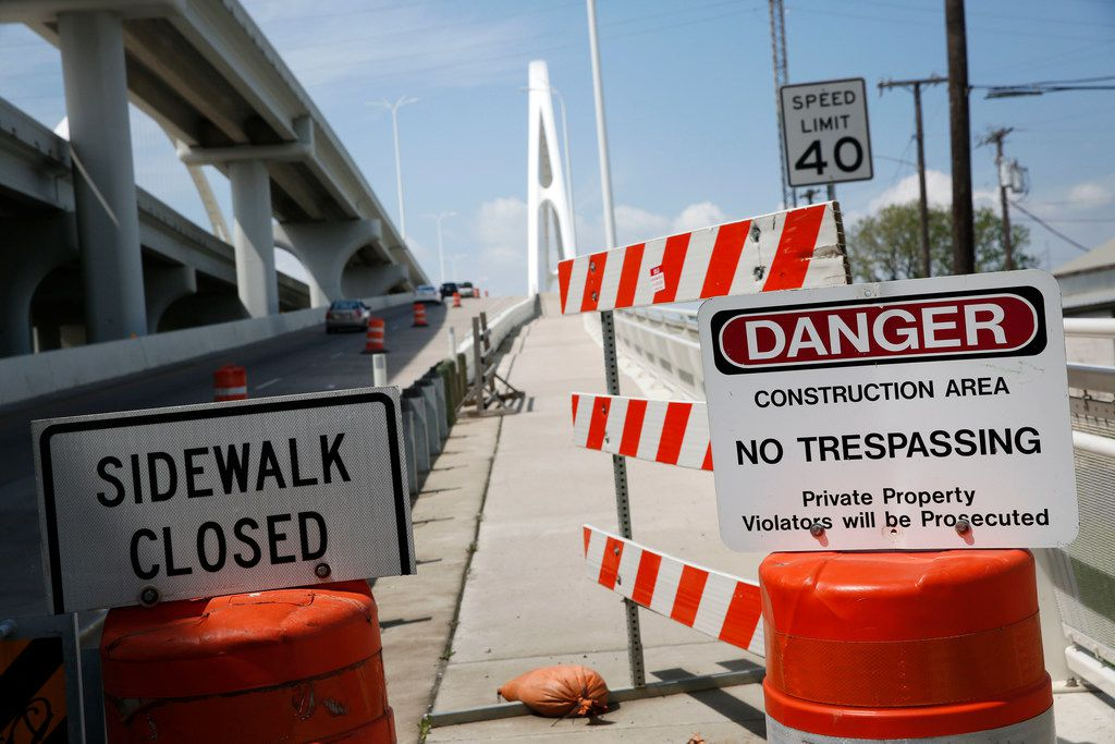 Signs prohibiting pedestrians from entering the hike-and-bike section along the Margaret McDermott Bridge in Dallas on Monday