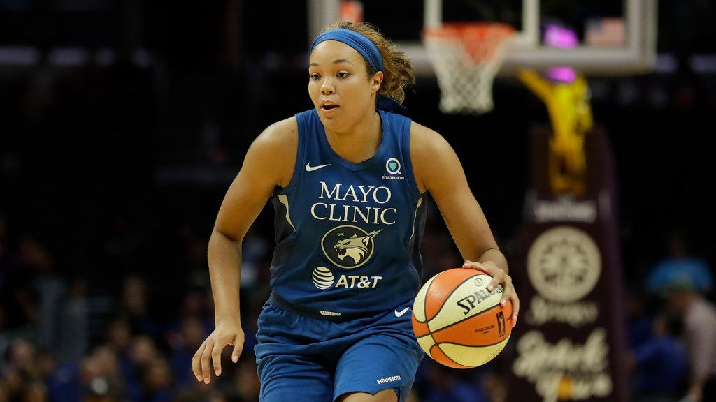 Minnesota Lynx forward Napheesa Collier plays against the Los Angeles Sparks during the first half of an WNBA basketball game in Los Angeles, Tuesday, Aug. 20, 2019. (AP Photo/Chris Carlson)