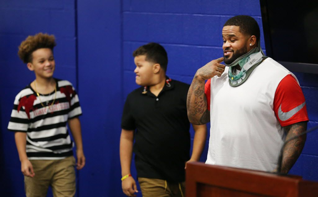 "Texas Rangers designated hitter Prince Fielder walks in with his sons Jadyn Fielder (left) and Haven Fielder, before speaking at a press conference at Globe Life Park in Arlington, Texas Wednesday August 10, 2016. It was announced that Fielder's career is ending due to his second spinal fusion surgery in the last 27 months. Fielder will be declared ""medically disabled,"" since doctors will not clear him to play baseball due to the risk involved with the two fusions. (Andy Jacobsohn/The Dallas Morning News)"