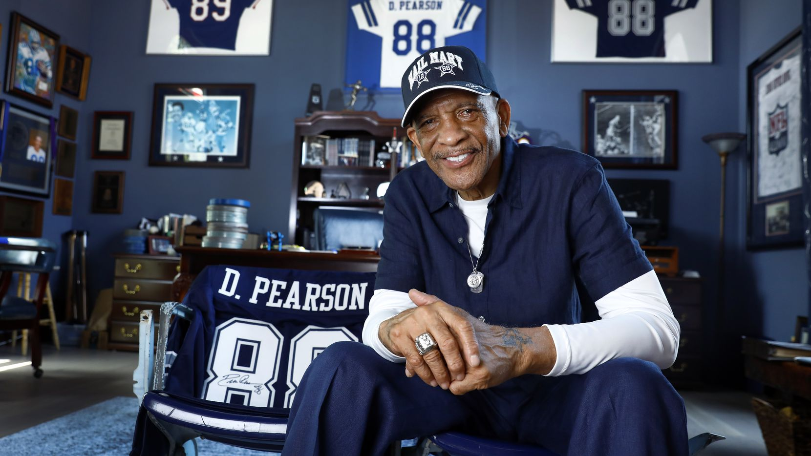Pro Football Hall of Fame inductee Drew Pearson poses for a photo on Texas Stadium seats inside his Plano home office. The former Dallas Cowboys wide receiver and original No. 88 was voted into the 2021 Hall of Fame class and will be inducted in Canton this summer.