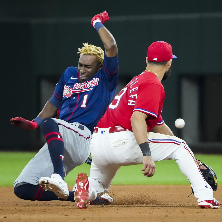 Minnesota Twins center fielder Nick Gordon is safe at second base with a double ahead of the throw to Texas Rangers shortstop Isiah Kiner-Falefa during the ninth inning at Globe Life Field on Friday, June 18, 2021.