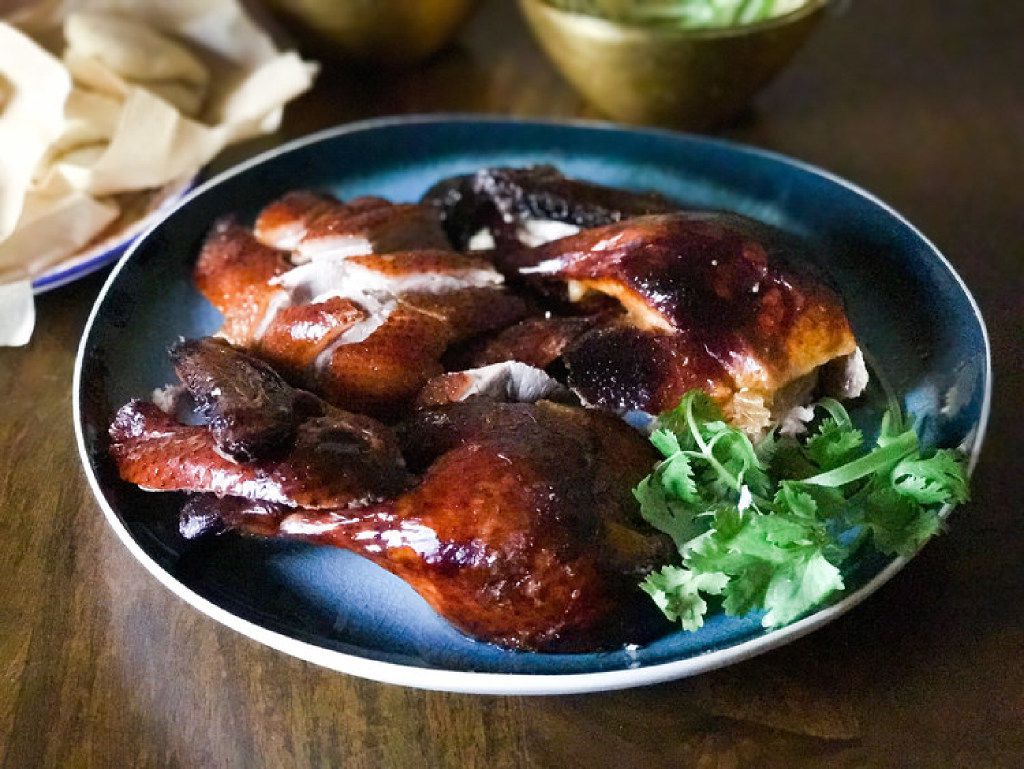 Carved lacquered roast duck