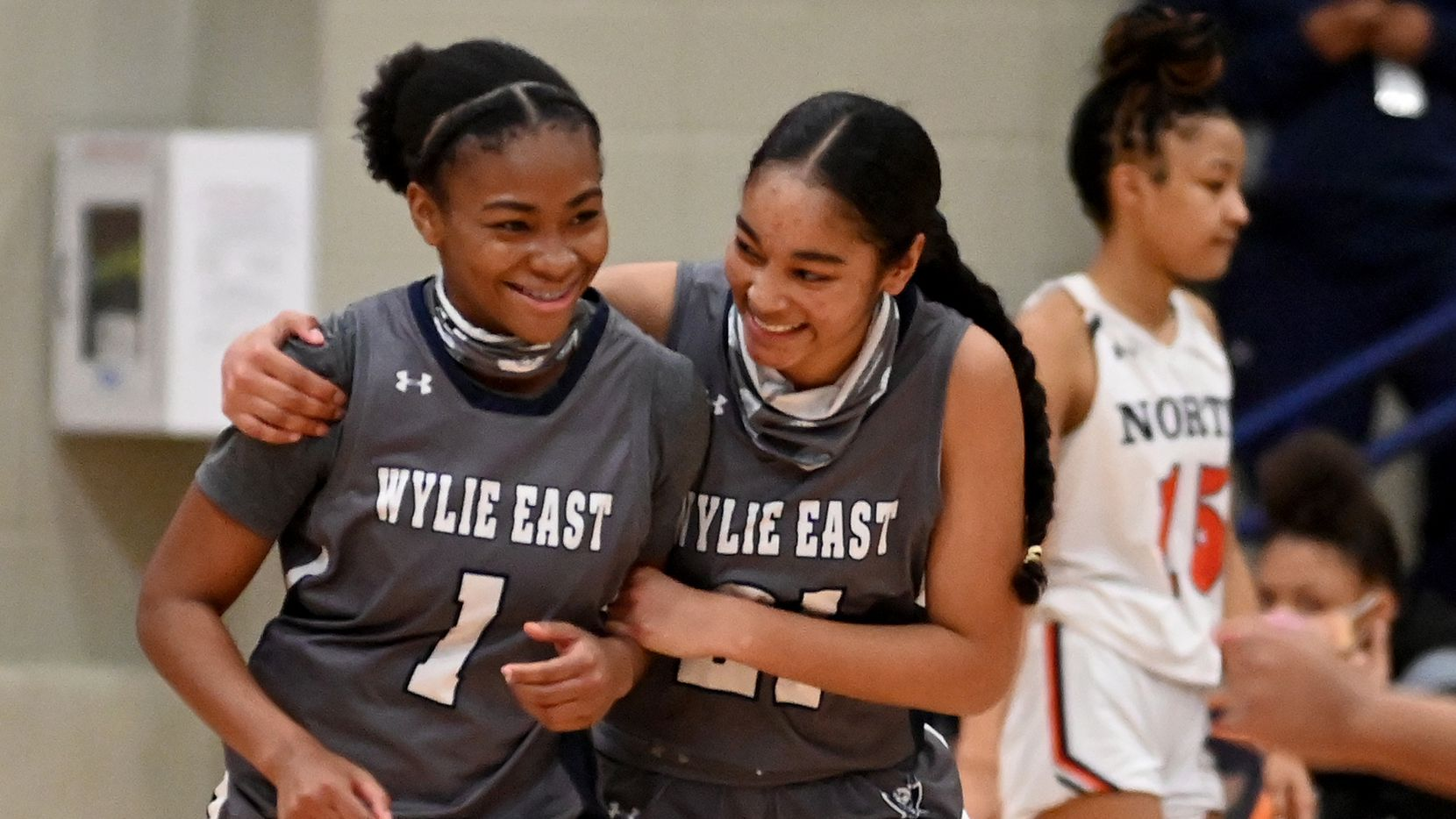Wylie East's Taylor Dailey (1) and Aleena Dawkins celebrate their double overtime win during a girls basketball game between Wylie East and McKinney North, Tuesday, Feb. 2, 2020, in McKinney, Texas.