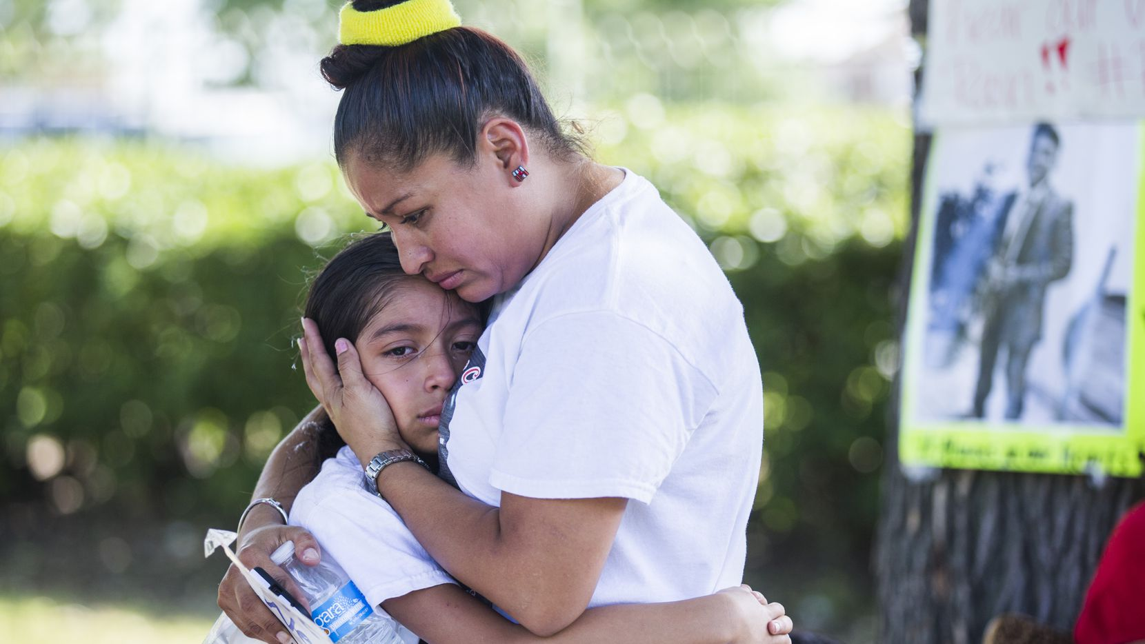 Jose Cruz's mother, Ana Henriquez, comforts Cruz's sister, Stephanie Eschriche, near Cruz's burial site on Friday, September 9, 2016 at Crown Hill Memorial Park in Dallas.