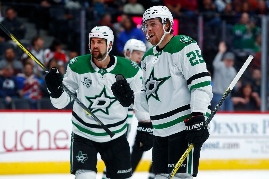 Dallas Stars right wing Brett Ritchie, right, celebrates his goal with left wing Jamie Benn against the Colorado Avalanche in the second period of an NHL hockey game Tuesday, Oct. 24, 2017, in Denver. (AP Photo/David Zalubowski)