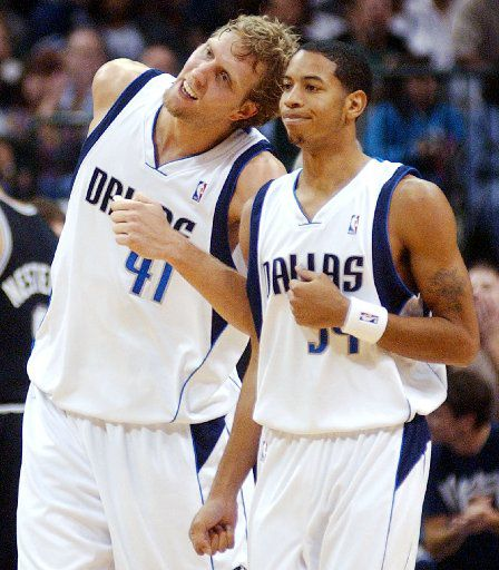 Dallas Mavericks' Dirk Nowitzki (41) of Germany playfully butts heads with Devin Harris (34) during the final minutes against the San Antonio Spurs on Saturday, Nov. 5, 2005 at American Airlines Center in Dallas. The Mavericks won 103-84. (AP Photo/Amy Conn-Gutierrez)