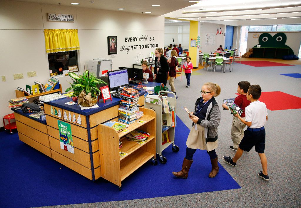 The rebuilt interior of the library on the west side of Shields Elementary. (Tom Fox/The Dallas Morning News)