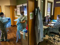 Texas will have at least 6,300 sites for administering coronavirus vaccines, though decisions on priority populations and public education are still being worked out. In photo, respiratory therapists discarded gowns after replacing a breathing tube for a patient in the COVID-19 intensive care unit at Parkland Memorial Hospital in Dallas last month.