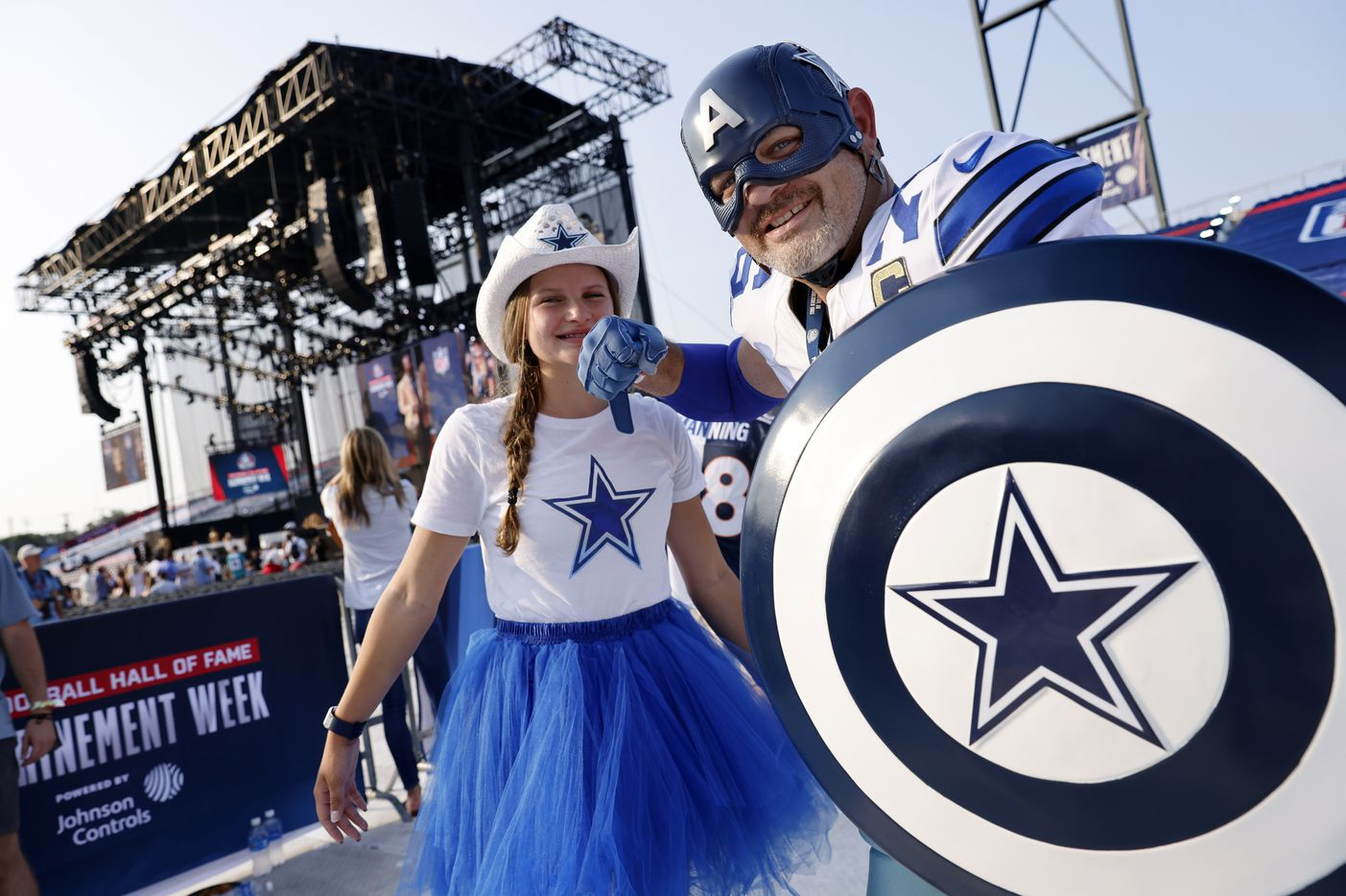 Dallas Cowboys fans Eric Welborn of Elkin, North Carolina and his 15 yr-old daughter Sophie pose for a photo in the Caption America's Team outfit during the Pro Football Hall of Fame Class of 2021 enshrinement ceremony at Tom Benson Hall of Fame Stadium in Canton, Ohio, Sunday, August 8, 2021. (Tom Fox/The Dallas Morning News)
