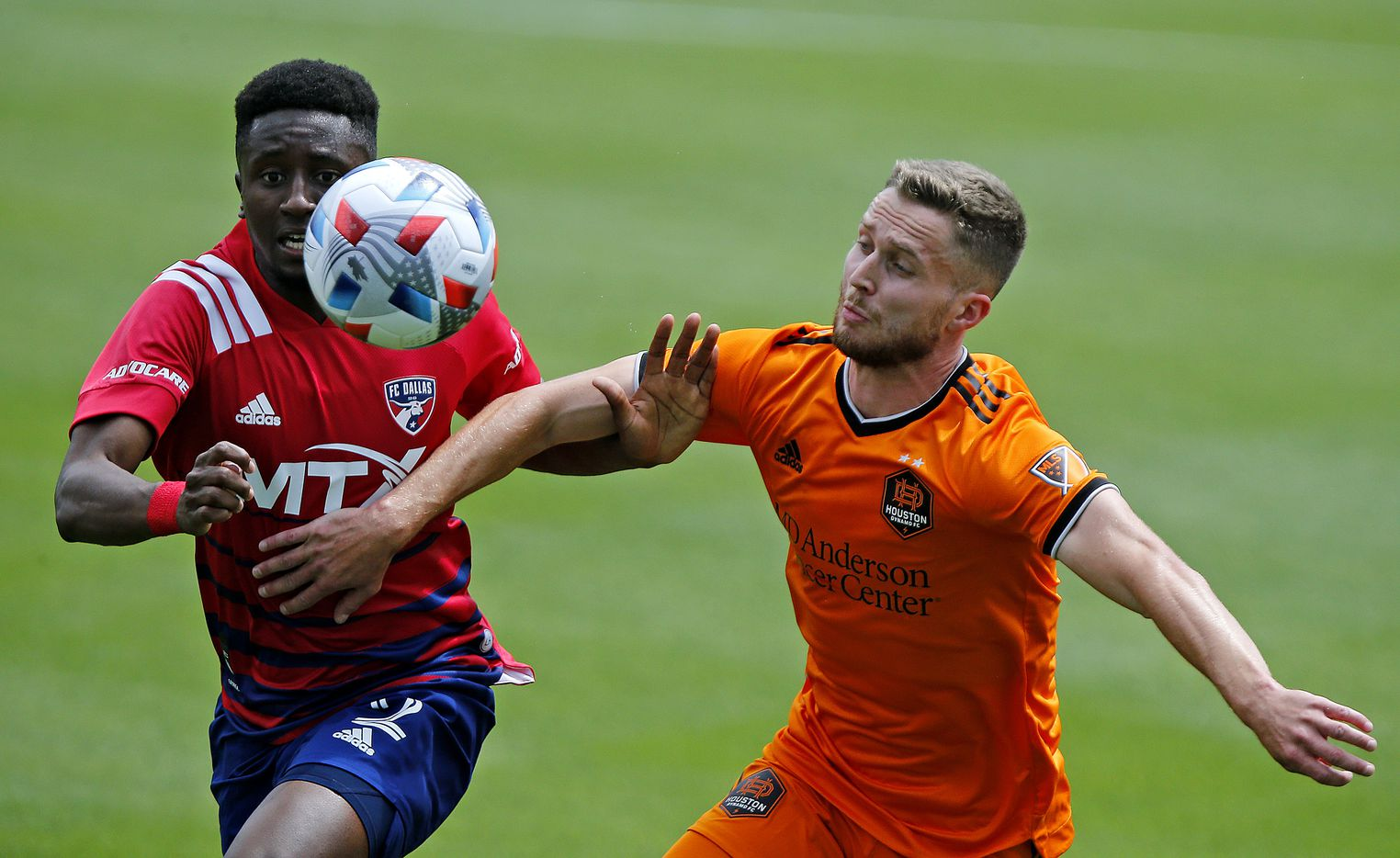 FC Dallas defender Eddie Munjoma (2) and Houston Dynamo defender Adam Lundqvist (3) race to the soccer ball during the first half as FC Dallas hosted the Houston Dynamo at Toyota Stadium in Frisco on May 8, 2021. (Stewart F. House/Special Contributor)