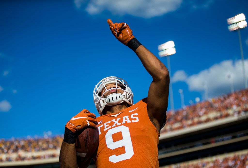 Texas Longhorns wide receiver Collin Johnson (9) celebrates in the end zone for a touchdown that was overturned by an offensive pass interference call during the second quarter of a college football game between the University of Texas and West Virginia on Saturday, November 3, 2018 at Darrell Royal Memorial Stadium in Austin, Texas. (Ashley Landis/The Dallas Morning News)