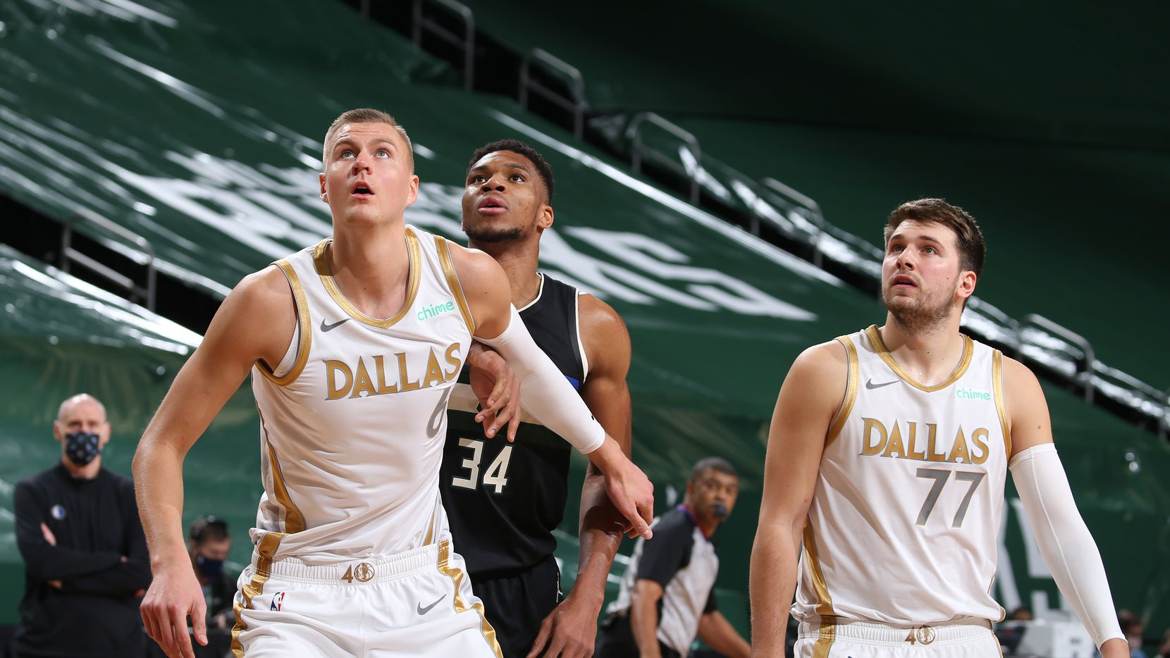 Mavericks forward Kristaps Porzingis (6), Bucks forward Giannis Antetokounmpo (34) and Mavericks guard Luka Doncic (77) are pictured during a game on Jan. 15, 2021, at Fiserv Forum in Milwaukee. (Photo by Gary Dineen/NBAE via Getty Images)